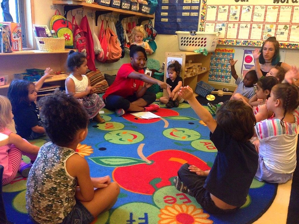 Program Associate Christina JeanBaptiste leading a CATCH lesson with a Kindergarten class at Mainspring School.